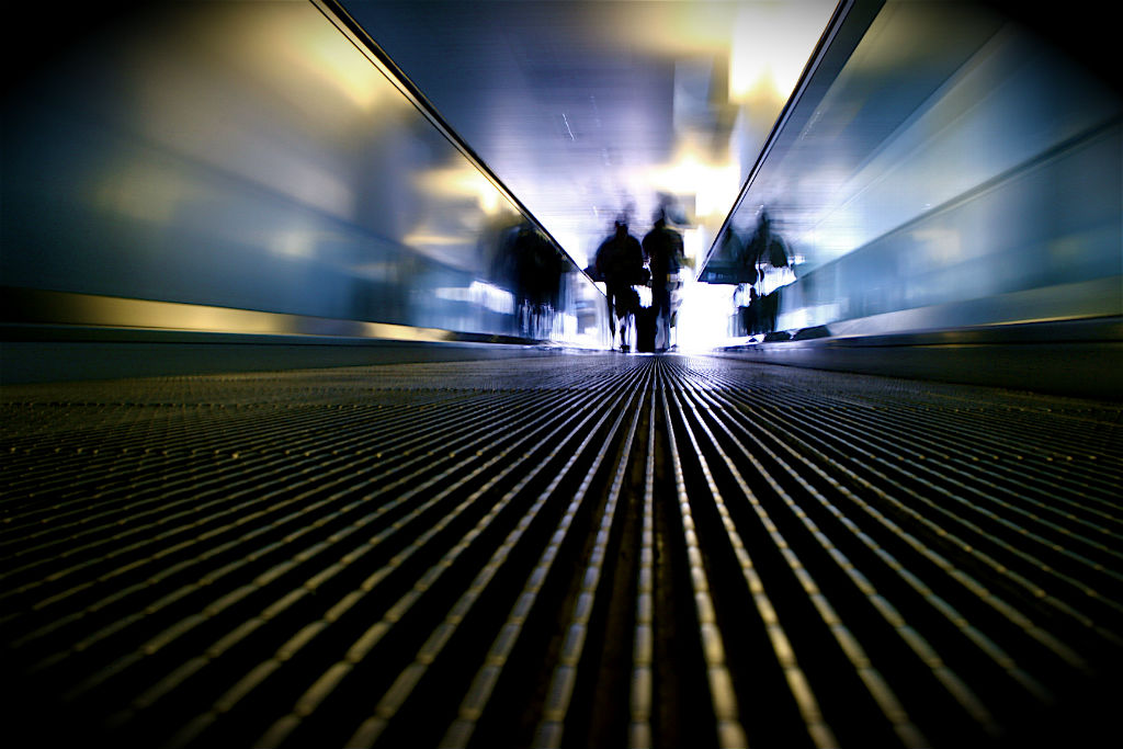 An airport travelator, moving walkway