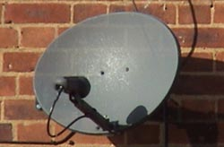 A satellite dish mounted on a wall